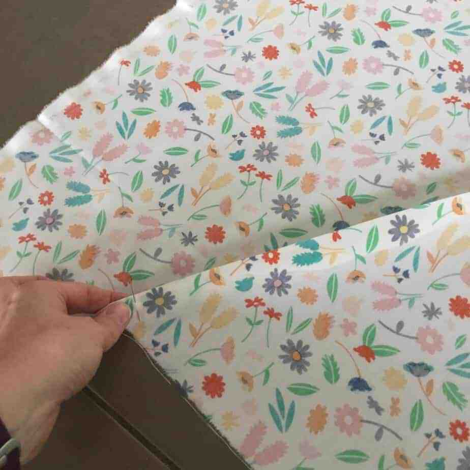 Picture Tutorial for piecing a quilt back diagonally, a great way of stretching fabric further!